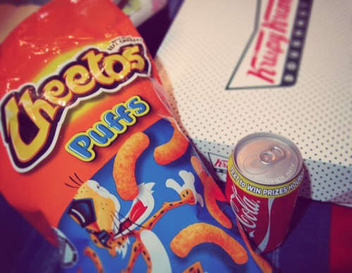 Cheetos Puffs and a Can of Coke